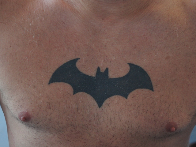 Jay Ruiz of the Brooklyn Bike Patrol shows off his Batman tattoo. The Prospect Heights native started the patrol a year ago after a string of sex attacks against women in Park Slope and Sunset Park.