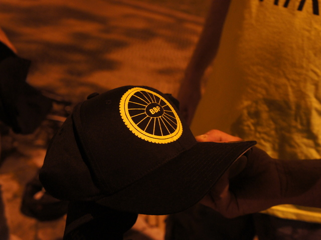 Jay Ruiz shows off new hats for the Brooklyn Bike Patrol. The Prospect Heights native started the patrol a year ago after a string of sex attacks against women in Park Slope and Sunset Park.