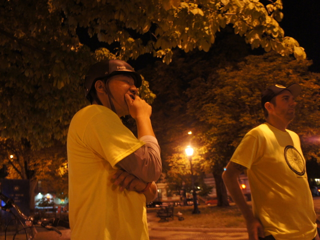 Ian Nomura, a member of the Brooklyn Bike Patrol, listens to leader Jay Ruiz talk about the group's upcoming anniversary. Ruiz started the patrol a year ago after a string of sex attacks against women in Park Slope and Sunset Park.