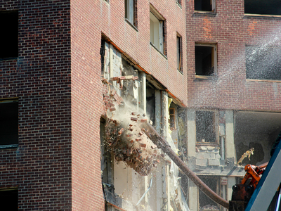 <p>Bulldozers bring down a seven story building Thursday, Sept. 13, 2012, the first of four high rises that will be demolished over the next several months.</p>