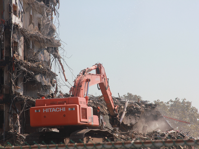 <p>Demolition of a seven story building began Thursday, Sept. 13, 2012, the first of four high rises that will be demolished over the next several months.</p>