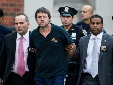 David Albert Mitchell, a 42-year-old homeless man from Virginia is led from Special Victims Unit in Harlem after being charged with rape and assault in Central Park on Septemeber 12th, 2012,