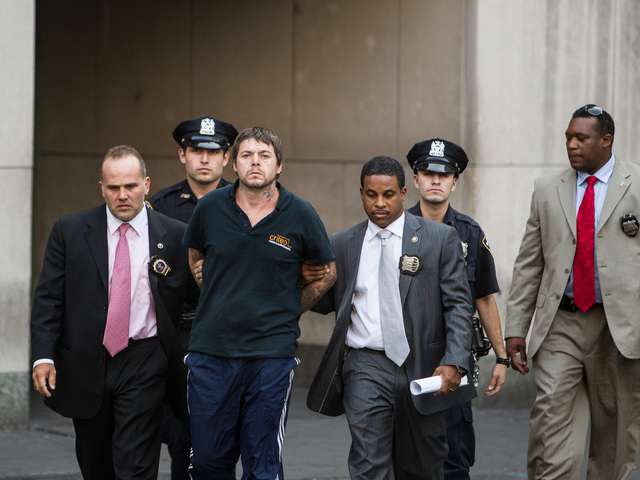 <p>David Albert Mitchell, 42, is led from Special Victims Unit in Harlem after being charged with the rape of a 73-year-old birdwatcher in Central Park on Sept. 12th, 2012.</p>
