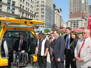 Victor Calise of the NYC Mayor's Office for People with Disabilities tests out one of the city's wheelchair-accessible taxis. The taxi is part of Accessible Dispatch, NYC's new wheelchair-accessible taxi service launched on Friday, Sept. 14, 2012.