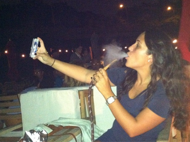 A woman smokes hookah at La Marina in September 2012.