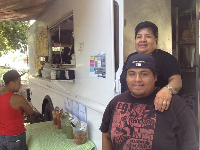 Eleazar and Fabian Perez greet customers outside the truck.