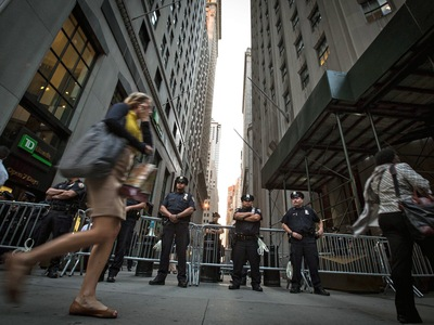 Cops stand guard in preparation for the Occupy Wall Street anniversary protest on Sept. 17, 2012.