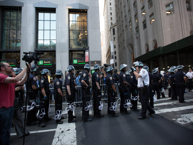 Police line up as protesters mark the anniversary of the Occupy Wall Street on Sept. 17, 2012.