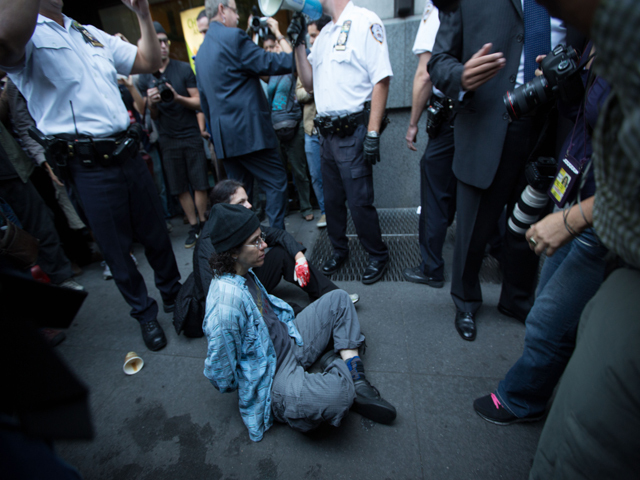 Protesters mark the anniversary of the Occupy Wall Street on Sept. 17, 2012.
