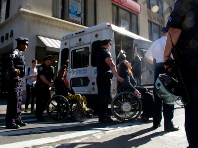 Three people in wheelchairs were detained by police at Liberty and Broadway Sept. 17, 2012.