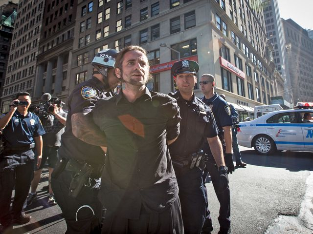Cops detain a protester during the demonstration marking the anniversary of the Occupy Wall Street movement on Sept. 17.