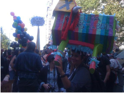 Protesters carried a piñata for the one-year-anniversary of Occupy Wall Street in Downtown Manhattan on Sept. 17, 2012.