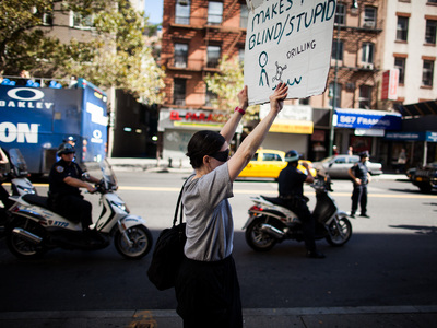 An Occupy Wall Street protester marches towards Foley Square during the anti-pipeline march on Sept. 16th, 2012.