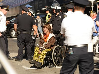 A wheelchair-bound demonstrator was arrested at the protest marking the anniversary of the Occupy Wall Street on Sept. 17, 2012.