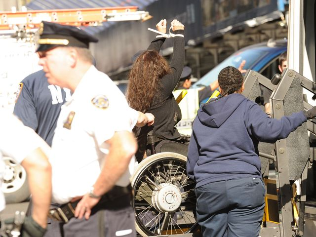 A wheelchair-bound demonstrator being arrested at the Occupy Wall Street protest on Sept. 17, 2012.
