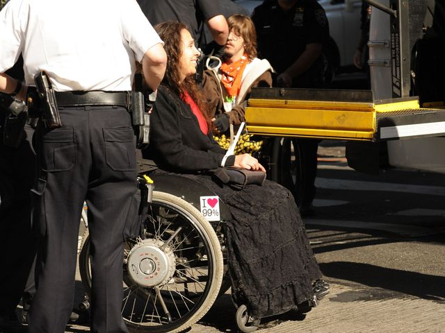 A wheelchair-bound demonstrator being arrested on Sept. 17, 2012.