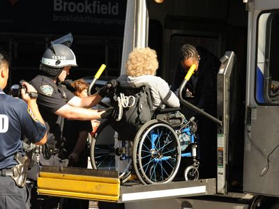 Cops arresting a wheelchair-bound protester at the Occupy Wall Street rally on Sept. 17, 2012.