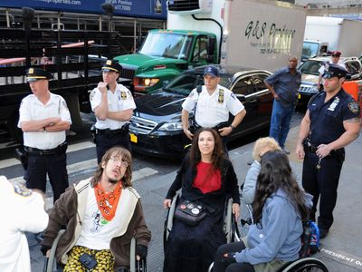 Cops arrested more than 100 protesters, including four wheelchair-bound demonstrators, on Sept. 17, 2012.