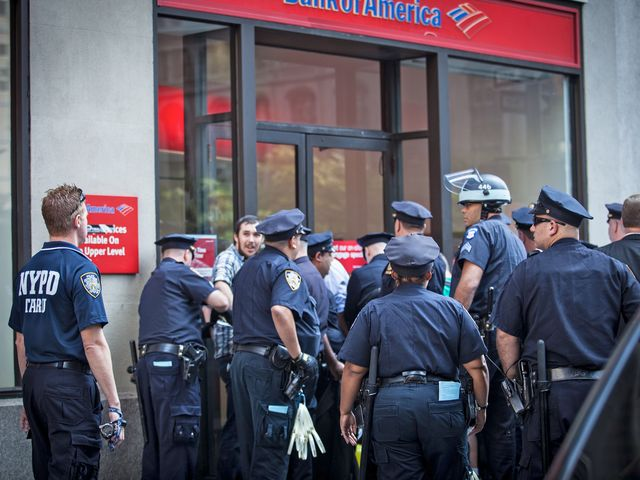 Cops arrested at least seven people at a Bank of America in the Financial District on Sept. 7, 2012.