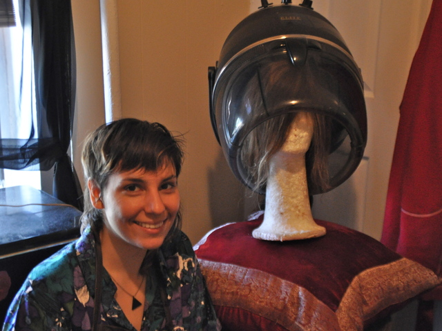 Nowicki keeps a helmet-style dryer in her bedroom to dry wigs that have been colored.