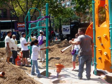 The Grote Street Apartments got a new playground and garden on Thursday as part of a group volunteer project.