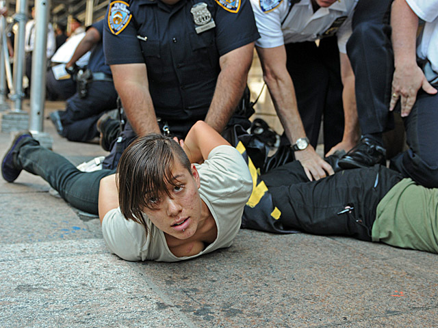 As a group of about 50 protesters marched out of Zuccotti Park, police told them to make room on the sidewalk, then arrested about four protesters on Monday afternoon near Church and Cortland Street.