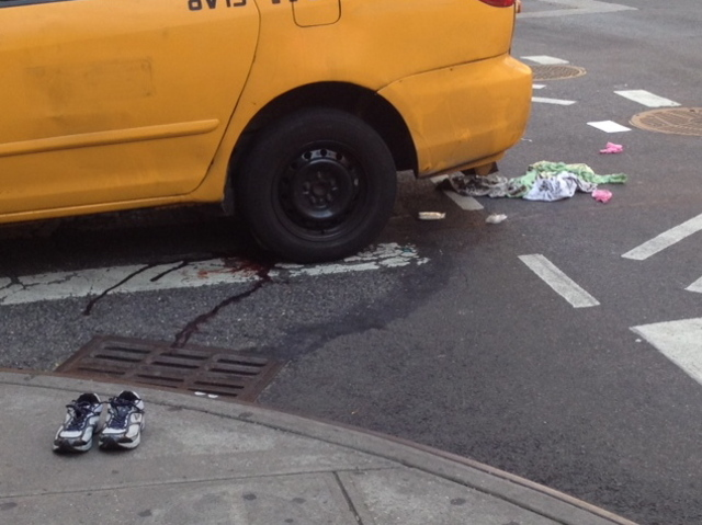The aftermath of an accident at East 69th Street and First Avenue. A taxi minivan struck and killed a 65-year-old Queens woman on Sept. 17, 2012.