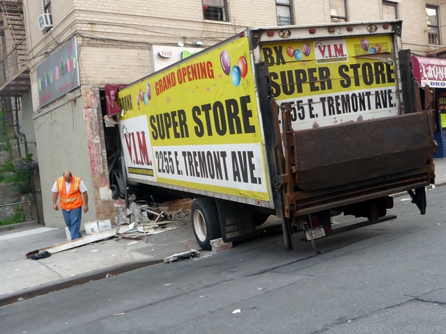 A parked tractor trailer with faulty brakes careened down a sloping Bronx street Monday afternoon, crashing through the front of a children's health clinic on East 188th Street.