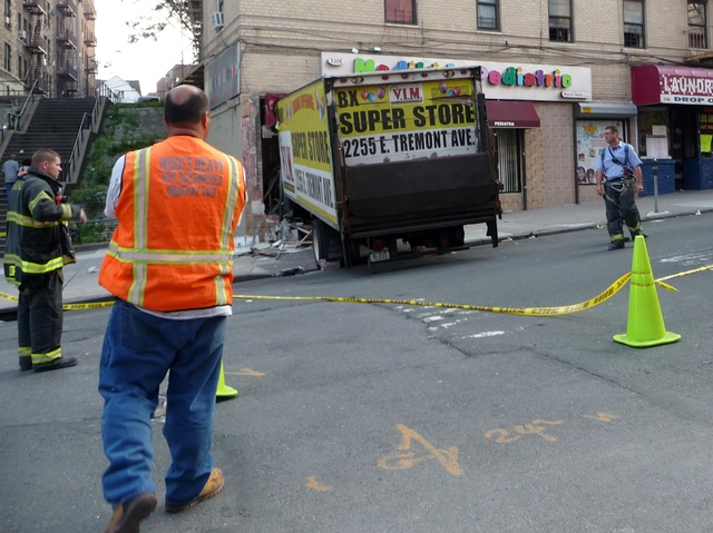 The vehicle was a delivery truck for V.I.M., a clothing store on East Tremont Avenue. Police said the accident was attributed to faulty brakes, and no criminality was involved.