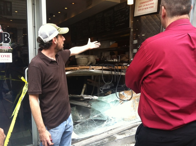 Andrew Fischel, owner of Rub BBQ, looked at the damage after a Hummer crashed into the restaurant Sept. 18, 2012.