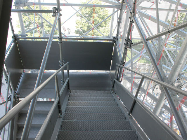 Stairs lead up to the living room. The exhibit is also wheelchair accessible by elevator.