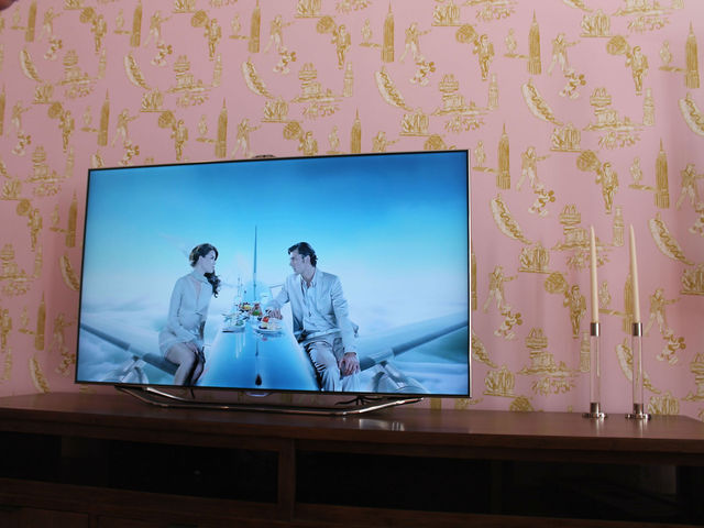 A new Samsung television is displayed in the living room, which has working power.