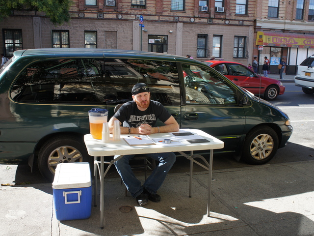<p>Luke Wheeler waits with a petition in support of Catfish Bar and Restaurant, a new late-night eatery in Crown Heights. A small but vocal group of neighbors have tried to block the restaurant&#39;s liquor license.</p>