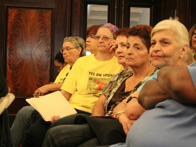 Stakeholders use yellow t-shirts to draw attention to a desire for affordable housing to remain an important part of the SPURA plan.