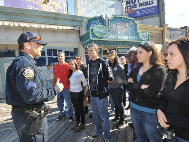 NYPD ESU Sgt. Jerry Flood briefs police cadets, who acted as hostages and bystanders during the drill on the set of Boardwalk Empire, Sept. 19, 2012.
