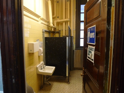 The grungy bathrooms at P.S. 124. Stalls in the girls' bathroom don't have doors.