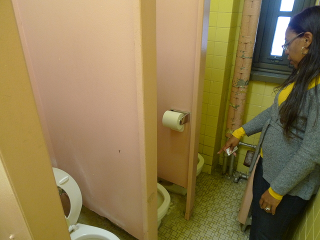 Toilets barely fit into stalls, which are missing doors, at P.S. 124's girls' bathroom.
