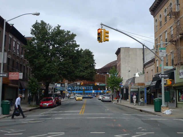 The intersection of Fifth Avenue and Bergen Street, with the Barclays Center visible in the background.