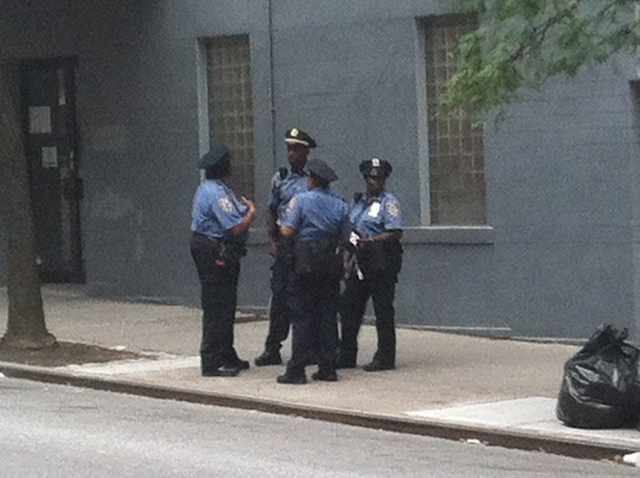 NYPD officers on West 56th Street after a 19-year-old student was stabbed there Sept. 20, 2012.