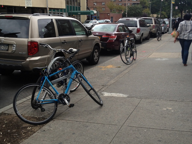 The bike racks outside Pushcart Coffee on East Broadway.
