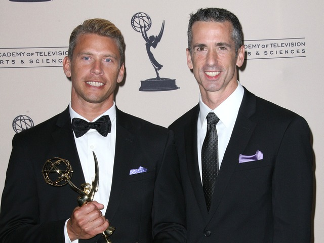 Dan Savage(R) and husband Terry Miller (L) attend The Academy Of Television Arts & Sciences 2012 Creative Arts Emmy Awards at the Nokia Theatre L.A. Live on September 15, 2012.