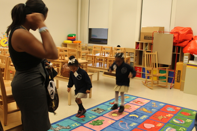 Kids play in their new classrooms at Teachers College Community School.