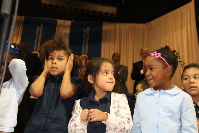 First-graders at Teachers College Community School perform during a welcoming ceremony.