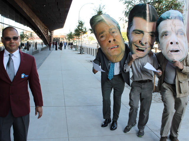 <p>Protesters outside the Barclays Center ribbon cutting wore giant masks of Brooklyn Borough President Marty Markowitz, Nets owner Mikhail Prokhorov and Gov. Andrew Cuomo.</p>