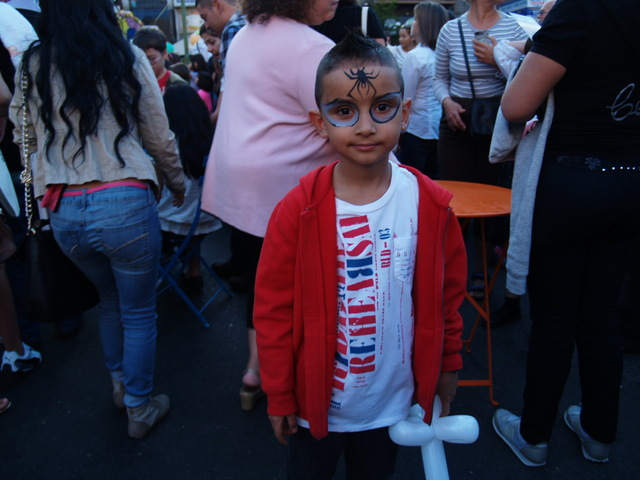 A young festival-goer has his face painted at Viva La Comida!