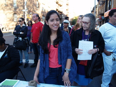 <p>Sofia Davila mans the 82nd Street Partnership booth, handing out information about the organization at the Viva La Comida! festival.</p>