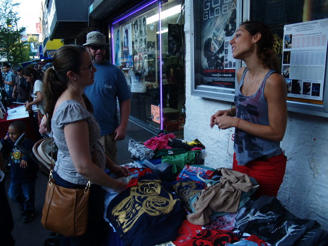 Clothing and art vendors were organized outside the Jackson Heights Cinema by Design For You.
