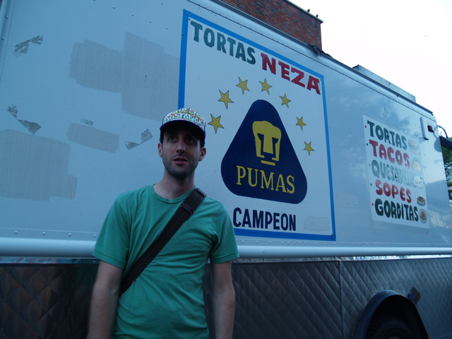 Food blogger Jeffrey Orlick, posing in front of the Tortas Nezas truck, picked all of the food vendors at the Viva La Comida! festival.
