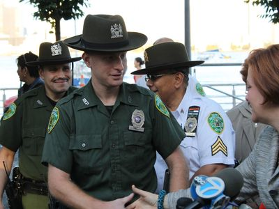 <p>Park Officer Daniel Murphy with City Council Speaker Christine Quinn at a rally to protest the rape of a woman there Saturday, Sept. 22, 2012.</p>