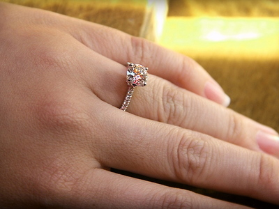Jenn Chen's new engagement ring with a 1.4 carat diamond in an antique-style setting.